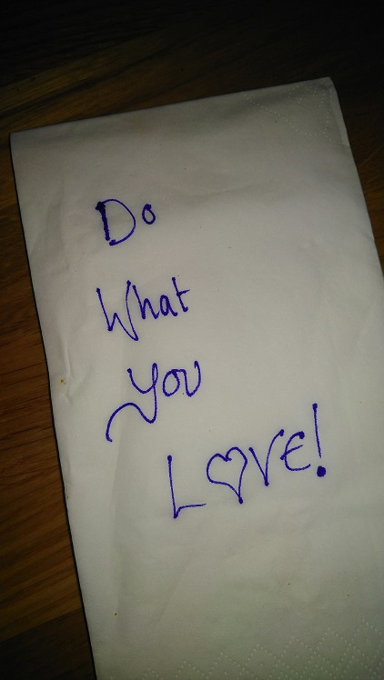 """A paper napkin with writing on it saying """"Do what you love!"""""""