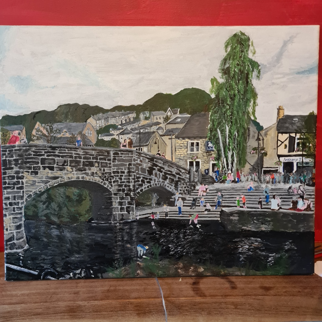 Painting of packhorse bridge and wavy steps in Hebden Bridge, houses in the background, the White Swan pub, people on the steps and children paddling in the river.